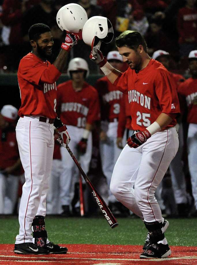 Houston first baseman Chris Iriart, right, celebrates his solo home run with outfielder Ashford Fullmer during the second inning of the second game of Houston's season-opening series against Minnesota, Saturday, February 14, 2015, at Cougar Field in Houston. Photo: Eric Christian Smith, For The Chronicle / 2015 Eric Christian Smith