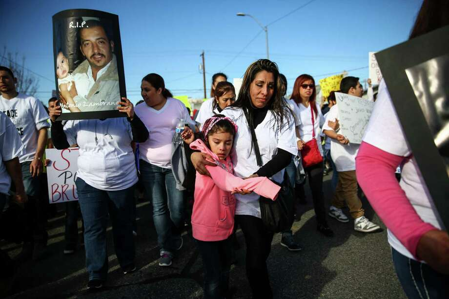 Linda Zambrano and Gina Ruiz, 5, relatives of Antonio Zambrano-Montes, march during a protest rally and march after Zambrano-Montes, a Mexican immigrant, was shot and killed by Pasco police officers. Zambrano-Monte's was throwing rocks at cars and officers when three of the officers shot and killed him. A video of the shooting has gone viral on social media, drawing significant attention to the Washington State community. Photographed on Saturday, February 14, 2015 in Pasco, Wash. Photo: JOSHUA TRUJILLO, SEATTLEPI.COM / SEATTLEPI.COM