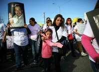 Linda Zambrano and Gina Ruiz, 5, relatives of Antonio Zambrano-Montes, march during a protest rally and march after Zambrano, a Mexican immigrant, was shot and killed by Pasco police officers. Zambrano-Monte's was throwing rocks at cars and officers when three of the officers shot and killed him. A video of the shooting has gone viral on social media, drawing significant attention to the Washington State community. Photographed on Saturday, February 14, 2015 in Pasco, Wash.