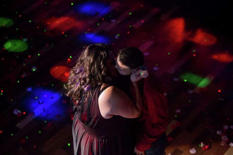 Melanie Longoria, left, and Marisol Longoria kiss during their wedding ceremony held by LGBT San Antonio at the San Antonio Country Saloon on Valentine's Day, Saturday, February 14, 2014. Photo: Carolyn Van Houten, Staff / San Antonio Express-News / 2015 San Antonio Express-News