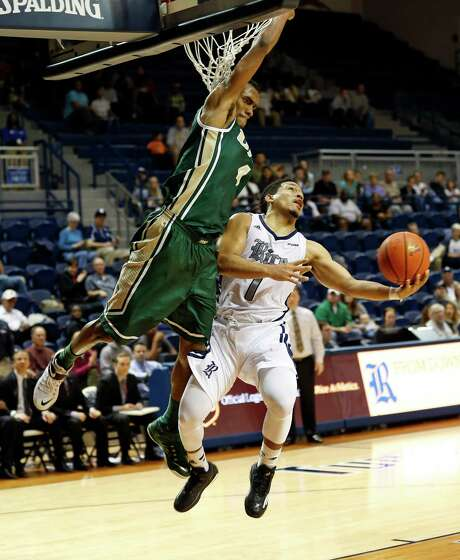UAB guard Robert Brown, left, plays bigger than his 6-5 height with aggressive defense on Rice's Max Guercy in the second half Saturday night. Photo: Craig Hartley, Freelance / Copyright: Craig H. Hartley