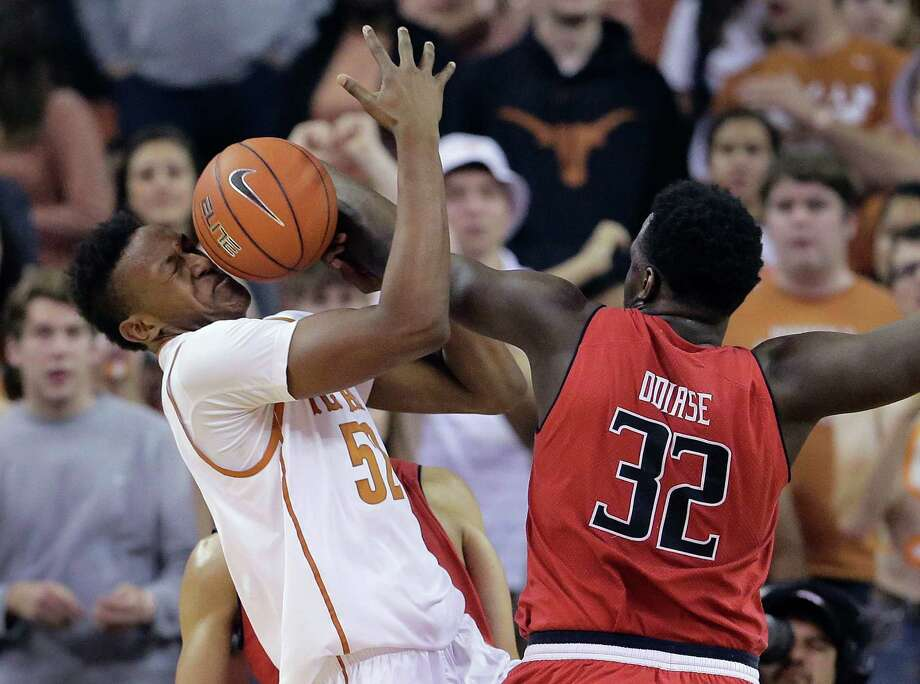 Texas' Myles Turner (52) is hit in the face with the ball as he and Texas Tech's Norense Odiase (32) scramble for a rebound during the first half of an NCAA college basketball game, Saturday, Feb. 14, 2015, in Austin, Texas. (AP Photo/Eric Gay) Photo: Eric Gay, STF / AP