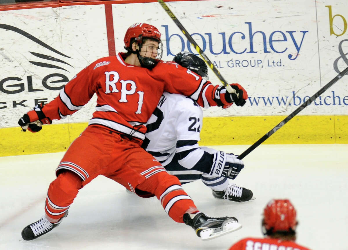 Rensselaer Polytechnic Institute's Viktor Liljegren(12) skates against Yale's Tommy Fallen (22) during the second period of an NCAA college hockey game in Troy, N.Y., Saturday, Feb. 14, 2015. (Hans Pennink / Special to the Times Union) ORG XMIT: HP113