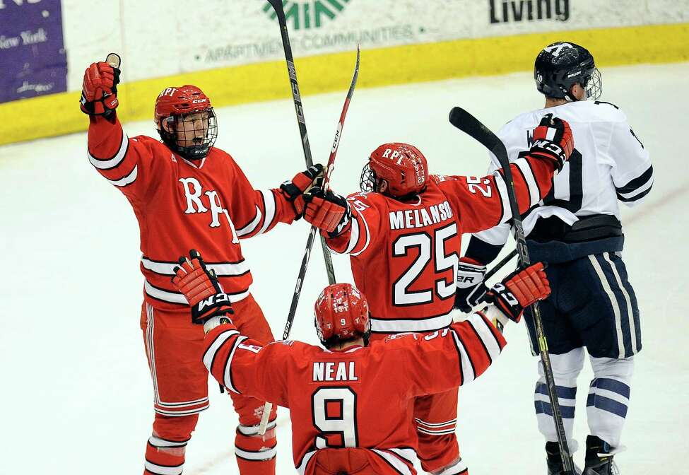 Rensselaer Polytechnic Institute's Viktor Liljegren ,left, celebrates with teammates after scoring against Yale during the first period of an NCAA college hockey game in Troy, N.Y., Saturday, Feb. 14, 2015. (Hans Pennink / Special to the Times Union) ORG XMIT: HP101