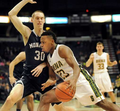 Siena's Maurice White, center, drives past Monmouth's Collin Stewart during their basketball game on Saturday, Feb. 14, 2015, at Times Union Center in Albany, N.Y. (Cindy Schultz / Times Union) Photo: Cindy Schultz / 00030520A
