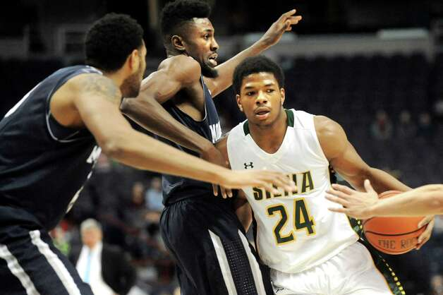 Siena's Lavon Long, right, runs into heavy defense from Monmouth's Brice Kofane, center, and Chris Brady during their basketball game on Saturday, Feb. 14, 2015, at Times Union Center in Albany, N.Y. (Cindy Schultz / Times Union) Photo: Cindy Schultz / 00030520A