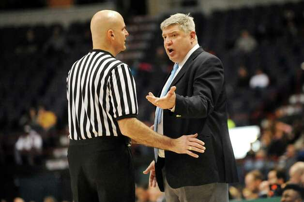 Siena's coach Jimmy Patsos, right, exchanges words with an official during their basketball game against Monmouth on Saturday, Feb. 14, 2015, at Times Union Center in Albany, N.Y. (Cindy Schultz / Times Union) Photo: Cindy Schultz / 00030520A