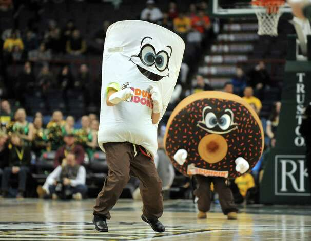 Dunkin' Donuts mascots have a dance competition during a timeout in Siena's basketball game against Monmouth on Saturday, Feb. 14, 2015, at Times Union Center in Albany, N.Y. (Cindy Schultz / Times Union) Photo: Cindy Schultz / 00030520A