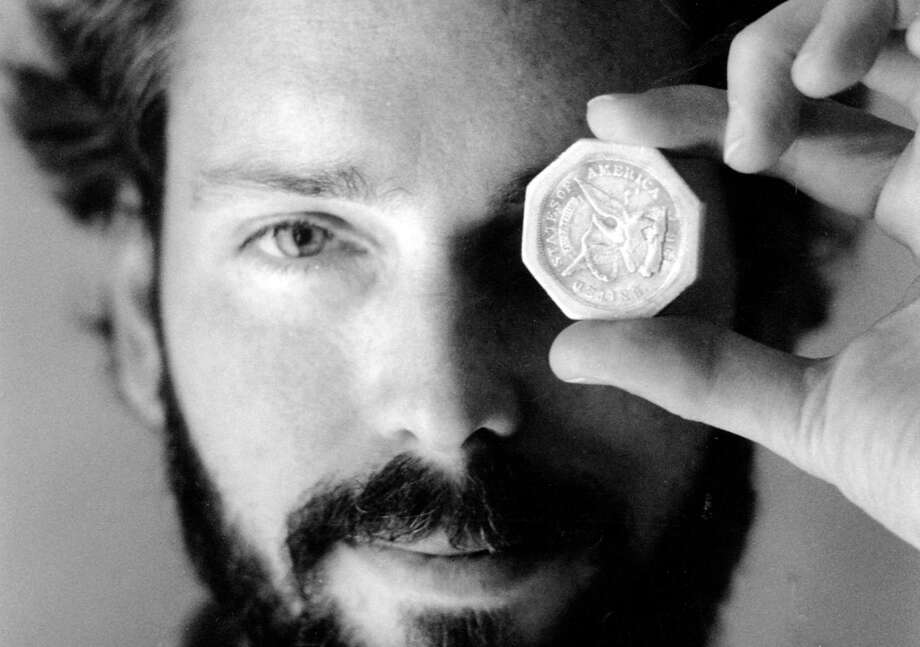 Tommy Thompson holds a $50 gold piece retrieved in 1989 from the wreck of the SS Central America. Photo: Lon Horwedel /Columbus Dispatch / Columbus Dispatch