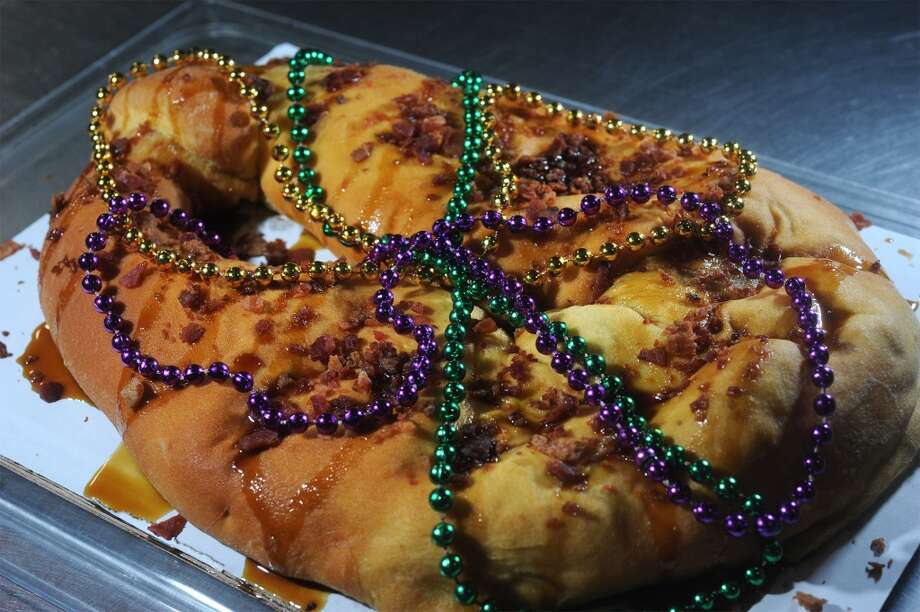 Topped with beads, bacon and two kinds of syrup, the boudin King Cake is a contemporary concoction of sweet and savory that Southeast Texans can use to celebrate Mardi Gras.  Photo taken Wednesday, February 04, 2015 Guiseppe Barranco/The Enterprise Photo: Guiseppe Barranco, Guiseppe Barranco/The Enterprise