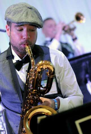 Jeff Nania plays the baritone saxophone with the  Brass-O-Mania Big Band during the 2015 Saratoga Dance Flurry at the Saratoga City Center on Saturday Feb. 14, 2015 in Saratoga Springs, N.Y. (Michael P. Farrell/Times Union) Photo: Michael P. Farrell / 00030601A