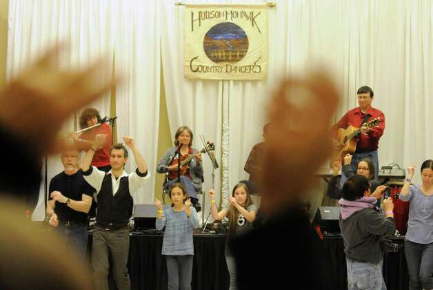 The FireFlies perform as Paul Rosenberg teaches Family dance during the 2015 Saratoga Dance Flurry at the Saratoga City Center on Saturday Feb. 14, 2015 in Saratoga Springs, N.Y. (Michael P. Farrell/Times Union) Photo: Michael P. Farrell / 00030601A