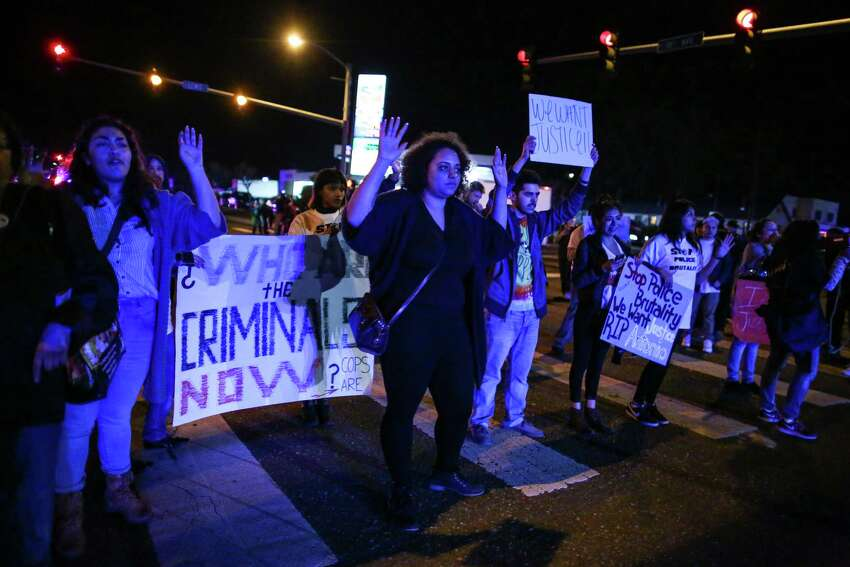 People gather in an intersection to stop traffic during a rally for Antonio Zambrano-Montes, Saturday, Feb. 14, 2015, in Pasco, Wash. Zambrano-Montes was shot and killed by Pasco police in Pasco on Tuesday. (AP Photo/seattlepi.com, Joshua Trujillo)
