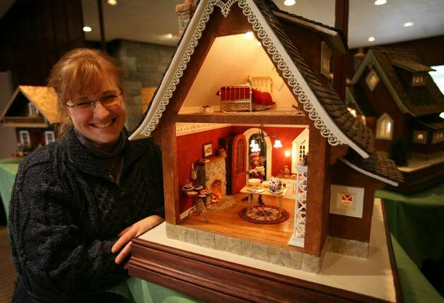 "Teresa Layman of Warren, CT with her gingerbread-style miniature house, part of the special exhibit ""The World of Miniatures"" at the annual quilt show at the Southport Congregational Church. Photo: Brian A. Pounds / Connecticut Post"