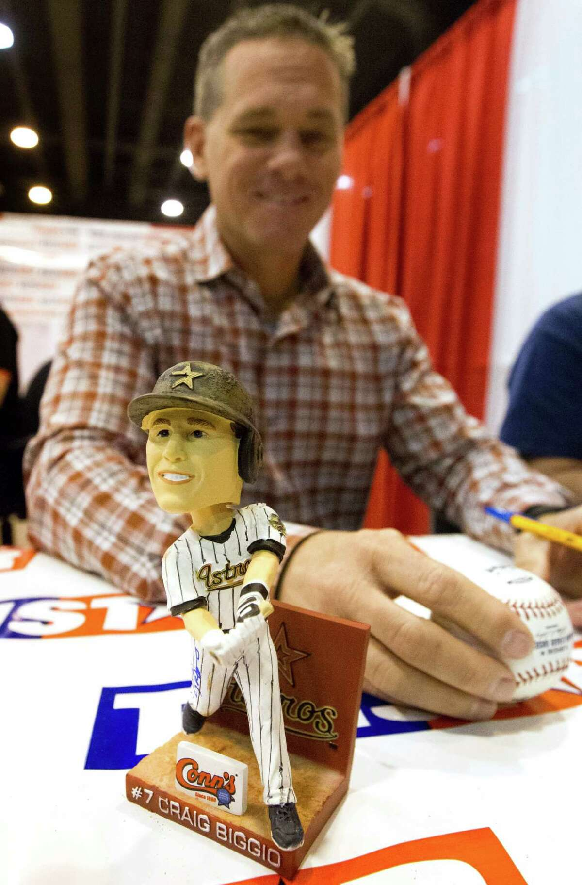 Former Houston Astro Craig Biggio signs a bobble head doll of himself during the Tristar autograph show at NRG park on Sunday, Feb. 15, 2015, in Houston.