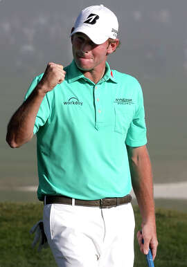 Brandt Snedeker fist-pumps after his final putt points him toward Augusta.