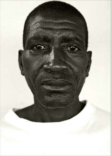 Angola, 2008 - Former rebel soldier. Photo: Giles Duley / Special To The Chronicle / ONLINE_CHECK