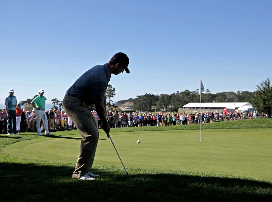 Giants' catcher Buster Posey chips up to the second hole green on the Pebble Beach Golf Links during the final round of the AT&T Pebble Beach National Pro-Am on Sunday Feb. 15, 2015, in Pebble Beach, Calif. Photo: Michael Macor / The Chronicle / ONLINE_YES