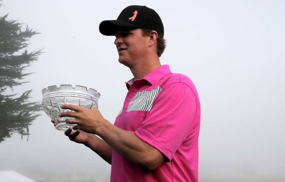 The Giants' Matt Cain receives the Jack Lemmon award, given to the amateur whose scoring helps his pro partner the most.