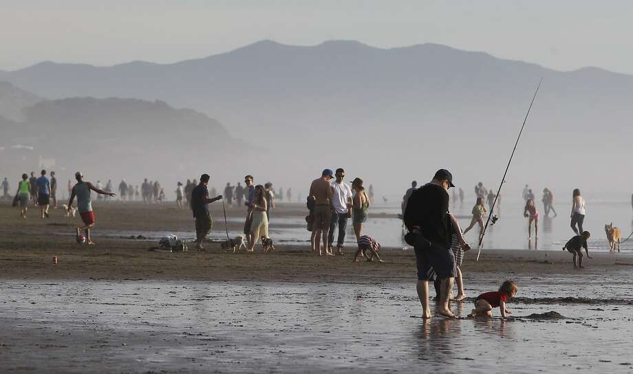 Hundreds of people flocked to Ocean Beach in San Francisco, Calif. Sunday, February 15, 2015 to enjoy the rare, warm February weather. Photo: Jessica Christian, The Chronicle