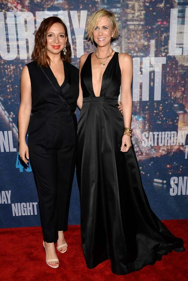 Maya Rudolph, left, and Kristen Wiig arrive at the Saturday Night Live 40th Anniversary Special at Rockefeller Plaza on Sunday, Feb. 15, 2015, in New York. (Photo by Evan Agostini/Invision/AP) Photo: Associated Press