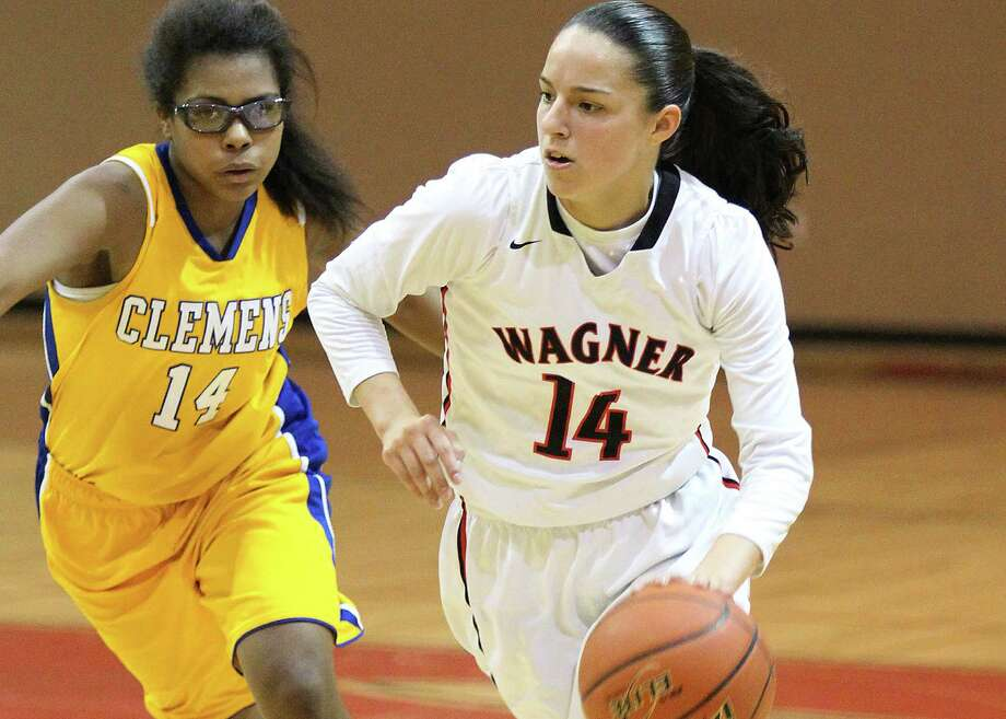 Wagner's Amber Ramirez (14) drives past Clemens' Teresa Lee during a District 25-6A game at Wagner on Jan. 20, 2015. Photo: Kin Man Hui /San Antonio Express-News / ©2015 San Antonio Express-News