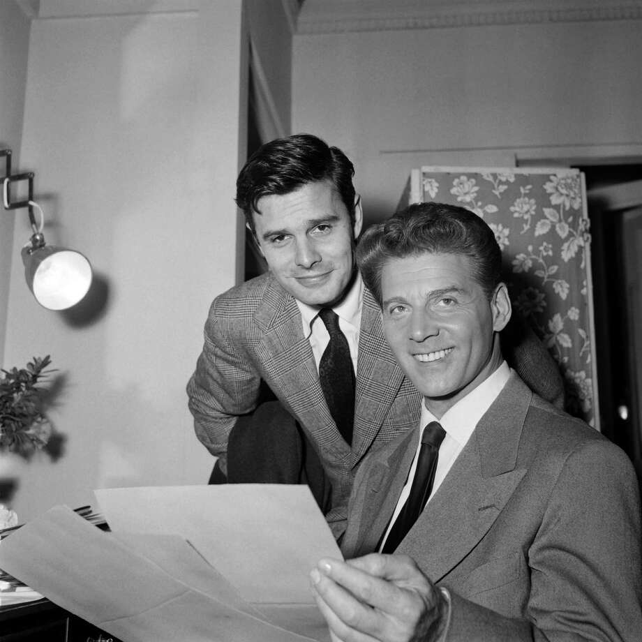 (FILES)-- A file photo taken in October 1954 shows French actor Louis Jourdan (L) and French singer Jean-Pierre Aumont working in Hollywood. French actor Louis Jourdan died on February 14, 2015 of natural causes at his home in Beverly Hills, Los Angeles, at the age of 93, his official biographer said on February 15. AFP PHOTO / STRINGER-/AFP/Getty Images Photo: -, Stringer / AFP