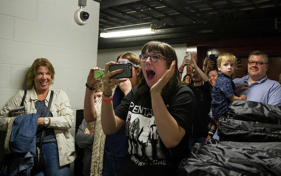 Jillian McDermott, 16, reacts to seeing Pentatonix backstage at the AT&T Center before performing at the San Antonio Stock Show & Rodeo on Sunday, while her mother Marchelle McDermont (far left) watches. McDermott and all the fans backstage bought the Rodeo Star Experience which includes a steak dinner, two drink tickets, parking, special seating for the rodeo, side-stage seating during the concert and a commemorative chair. Photo: Alma E. Hernandez /For The Express-News