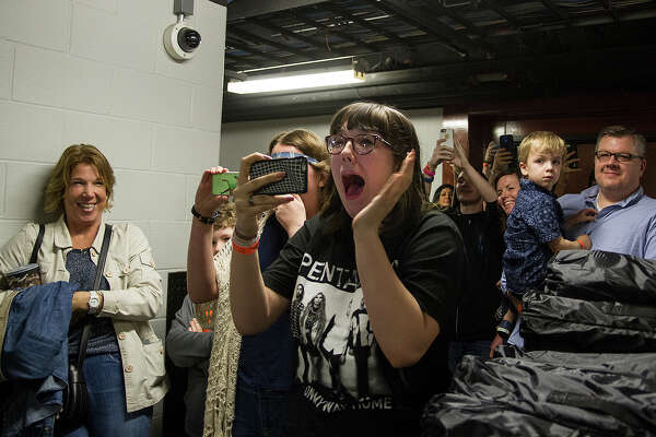 Jillian McDermott, 16, reacts to seeing Pentatonix backstage at the AT&T Center before performing at the San Antonio Stock Show & Rodeo on Sunday, while her mother Marchelle McDermont (far left) watches. McDermott and all the fans backstage bought the Rodeo Star Experience which includes a steak dinner, two drink tickets, parking, special seating for the rodeo, side-stage seating during the concert and a commemorative chair.