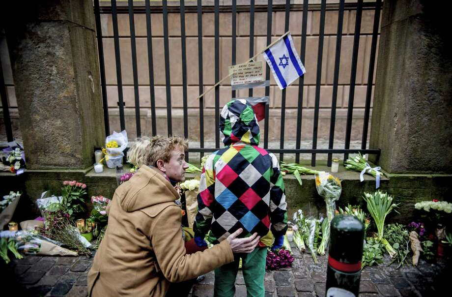 Flowers are placed Sunday outside the Copenhagen synagogue that was the scene of a terrorist attack. Photo: Rumle Skafte, SUB / POLFOTO