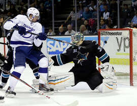 Sharks goalie Antti Niemi, who made 28 saves, can't handle a redirection by Alex Killorn (left) of Ryan Callahan's second-period shot as Tampa Bay took a 2-0 lead.