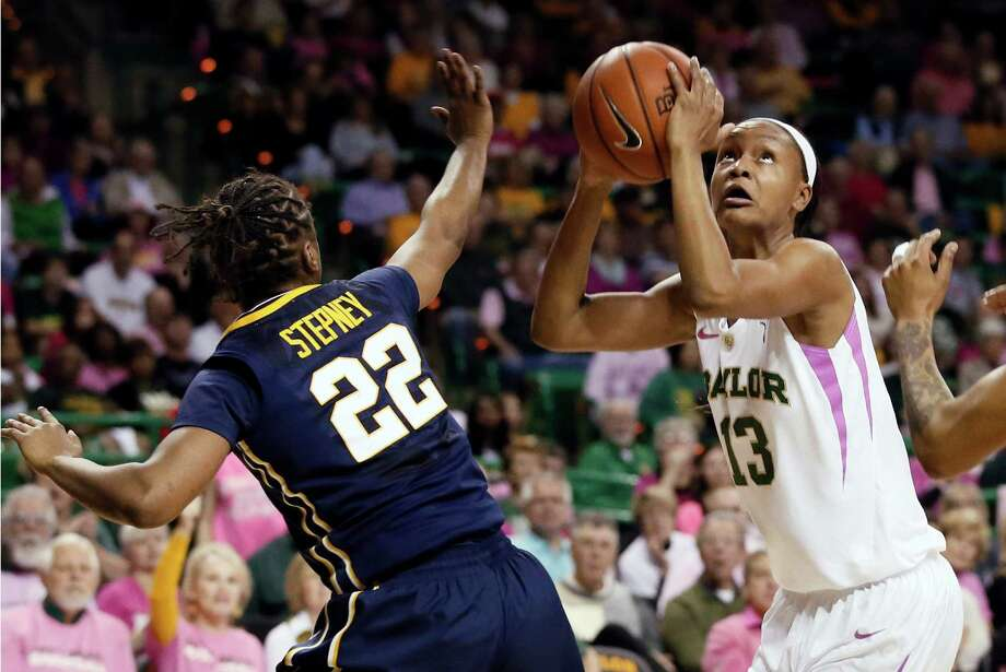Baylor's Nina Davis (13) looks to shoot against West Virginia's Linda Stepney in the first half of Sunday's game in Waco. Davis scored 22 points in the Lady Bears' 79-51 victory. Photo: Tony Gutierrez, STF / AP