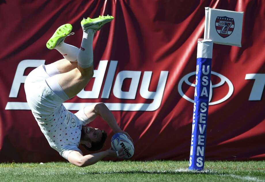 Charlie Hayter #2 of England does a summersault to score a try against France during the USA Sevens Rugby tournament at Sam Boyd Stadium. Photo: Ethan Miller /Getty Images / 2015 Getty Images