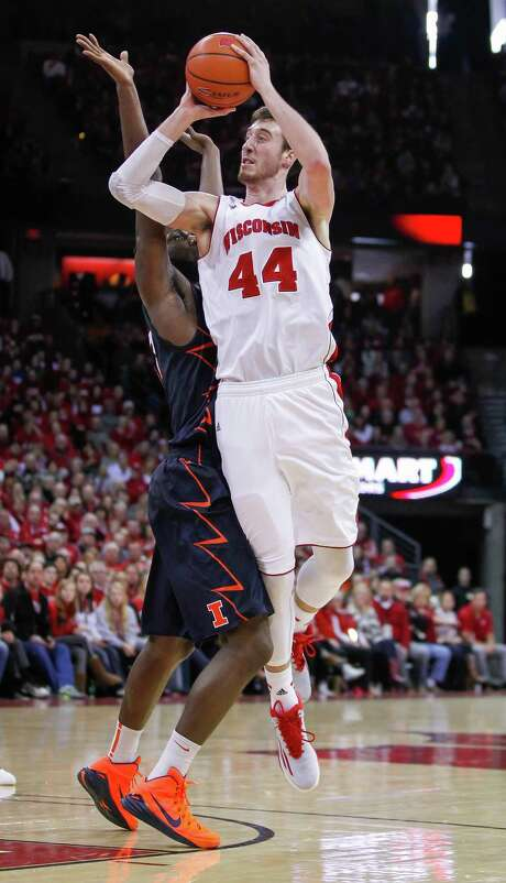 Wisconsin's Frank Kaminsky (44) goes up against Illinois' Nnanna Egwu for two of his 23 points in the fifth-ranked Badgers'  68-49 victory at Madison, Wis. Photo: Andy Manis, FRE / FR19153 AP