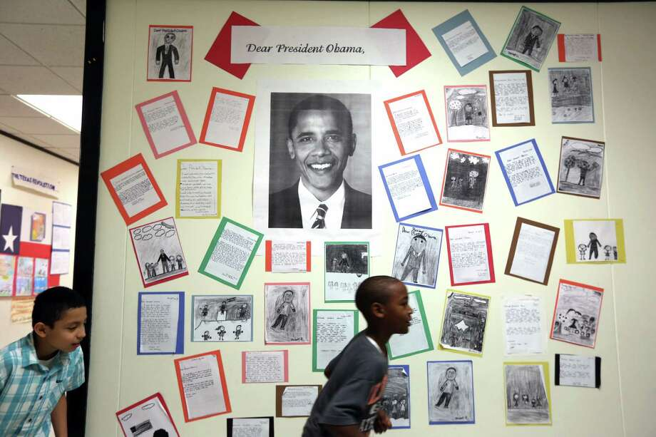 Copies of letters written by students to President Barack Obama are on display at Morgan Elementary School in Galveston, Photo: Gary Coronado, Staff / © 2015 Houston Chronicle