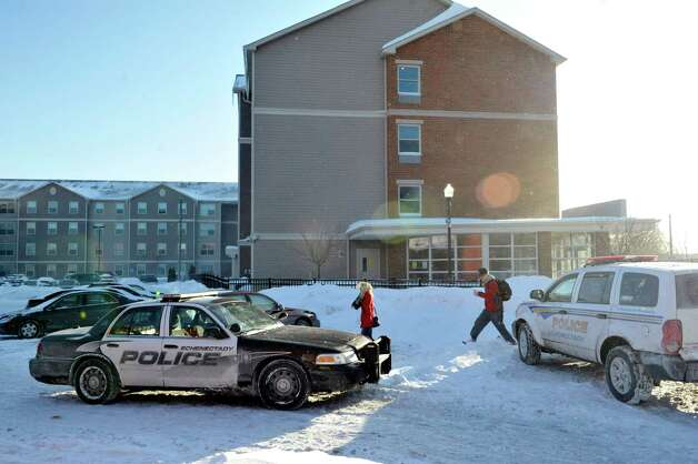 Students make their way out of the Schenectady County Community College dorms on Sunday, Feb. 15, 2015, in Schenectady, N.Y.  Earlier two men were stabbed in the building before running out of the building.  (Paul Buckowski / Times Union) Photo: Paul Buckowski