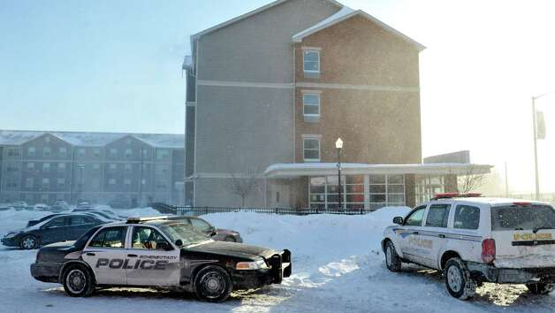 Police vehicles are seen at the Schenectady County Community College dorms on Sunday, Feb. 15, 2015, in Schenectady, N.Y.  Earlier two men were stabbed in the building before running out of the building.  (Paul Buckowski / Times Union) Photo: Paul Buckowski