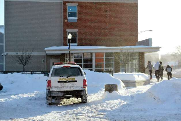 Students make their way into the  Schenectady County Community College dorms on Sunday, Feb. 15, 2015, in Schenectady, N.Y.  Earlier two men were stabbed in the building before running out of the building.  (Paul Buckowski / Times Union) Photo: Paul Buckowski