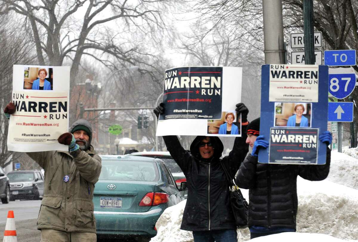 Capital District citizens rally in support of effort to encourage Elizabeth Warren to run for president on Broadway on Saturday Feb. 14, 2015 in Saratoga Springs, N.Y. (Michael P. Farrell/Times Union)