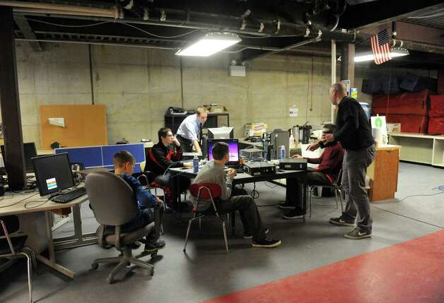 Patrick Massin, right, with Open Source Initiative and Maple Hill Middle School technology teacher Kris Navratil work with 6-8th grade students on building computersin the Schodack school basement on Friday Feb. 6, 2015 in Castleton-on-Hudson, N.Y.  (Michael P. Farrell/Times Union) Photo: Michael P. Farrell / 00030461A