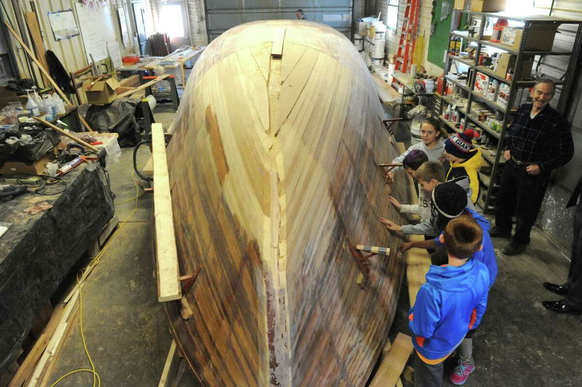 Retired RPI professor David Borton, right, works with Maple Hill Middle School sixth grade students on building a 40 foot solar electric cargo boat on Friday Feb. 6, 2015 in Castleton-on-Hudson, N.Y. (Michael P. Farrell/Times Union)