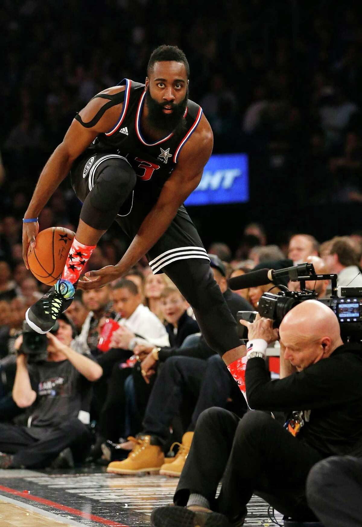 West Team's James Harden, of the Houston Rockets, tries to keep the ball inbounds during the second half of the NBA All-Star basketball game, Sunday, Feb. 15, 2015, in New York. (AP Photo/Kathy Willens)