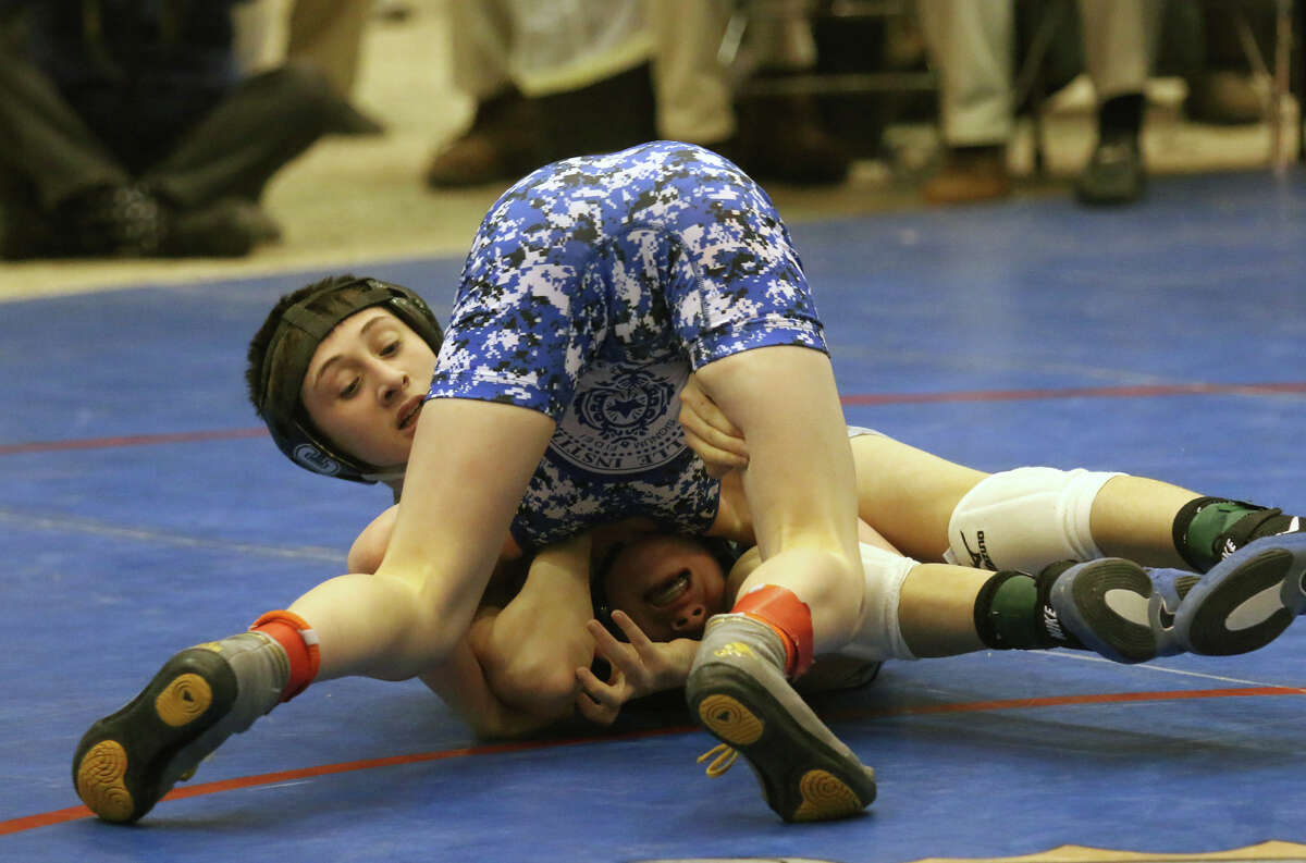 Columbia's Michael Gonyea, back, wrestles to victory at 99 over La Salle's Caiden Mondore during Division I Section II wrestling championship finals Sunday, February 15, 2015 at the Glens Falls Civic Center. (Ed Burke / Special to the Times Union)