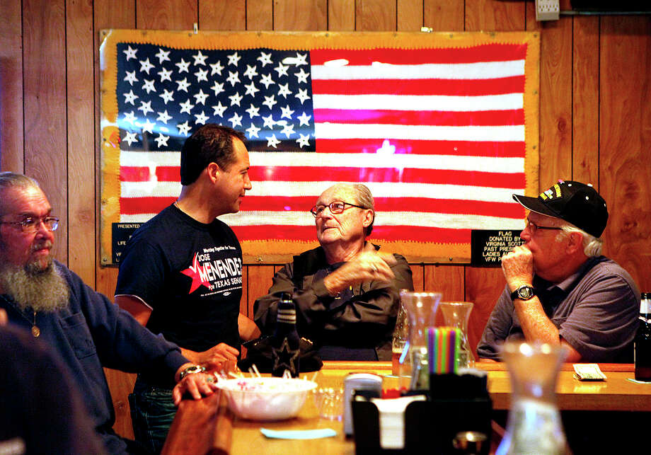 Sporting a campaign shirt, José Menéndez speaks with supporters Ernest Dalton (center) and Richard Huber at VFW Post 9174 on Pinn Road. Photo: Cynthia Esparza /For The San Antonio Express-News / For the San Antonio Express-News