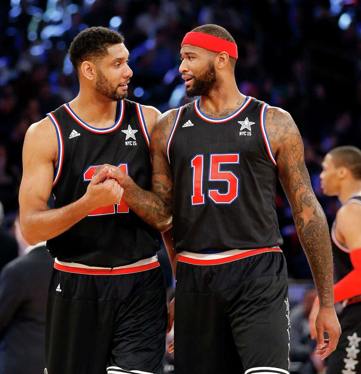 Spurs big man Tim Duncan, left, of the San Antonio Spurs, and DeMarcus Cousins, of the Sacramento Kings, talk during the second half.