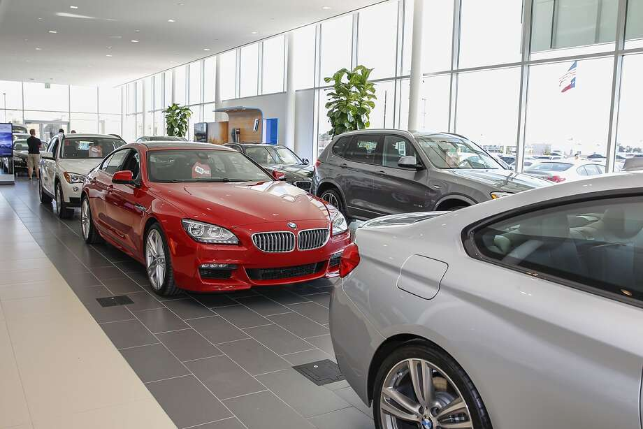new bmw models line the inside of the showroom at bmw of west houston a porter dealership