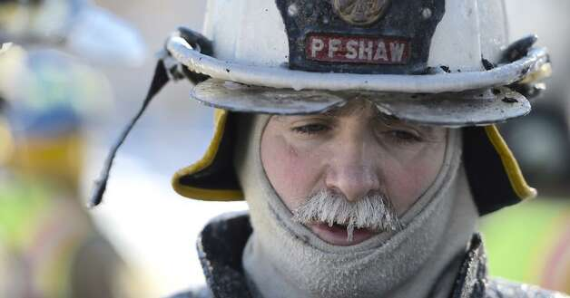 Malta Ridge Chief Pete Shaw had icicles hanging from his mustash due to the extreme cold at a house fire fire in Malta on Monday. (Skip Dickstein / Times Union)