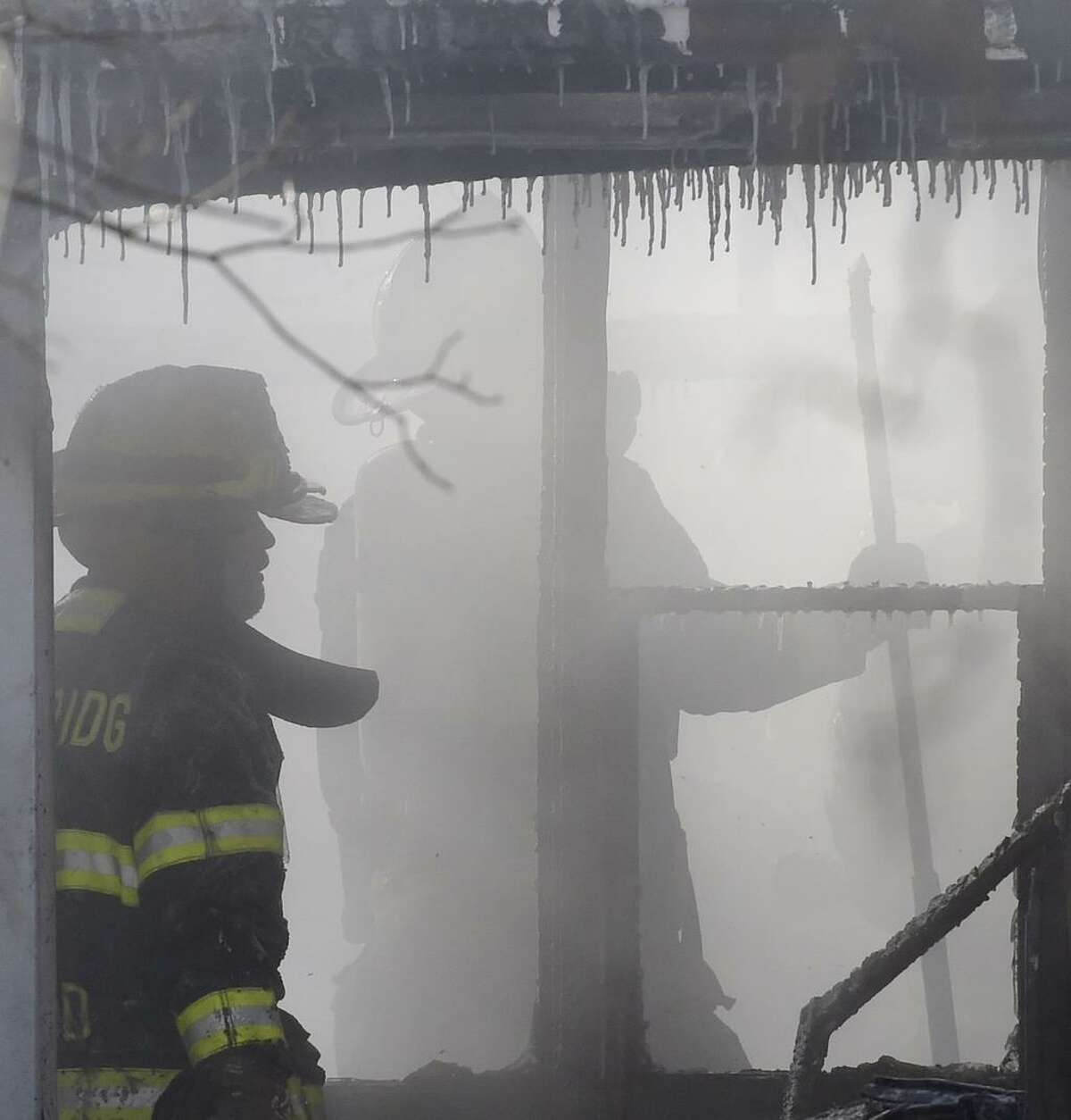 Firefighters battled a house fire at 12 North Ridge in Malta Monday morning. The fire caused extensive damage to the home. (Skip Dickstein / Times Union)