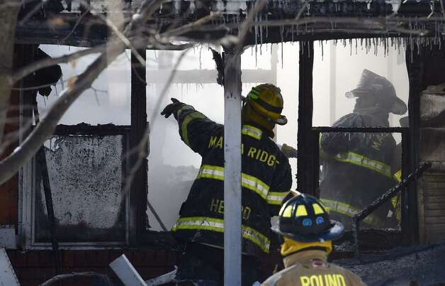 Firefighers battled a house fire Monday morning at 12 North Ridge in Malta on Monday. (Skip Dickstein / Times Union)