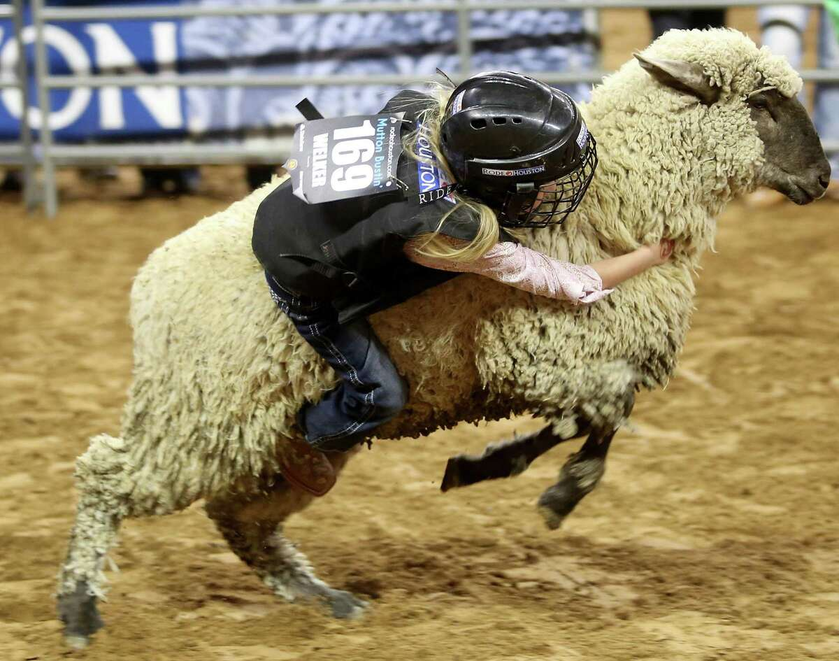 All of sudden we really get excited about kids being thrown off sheep at a frightening speed.  The youngest competitors at RodeoHouston try to stay on a sheep for 8 seconds.